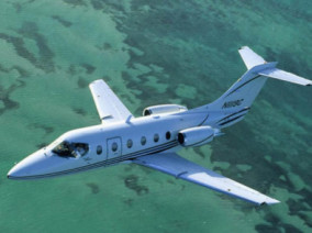Hawker 400 XP, Air Taxi, used by Private Jet Charter service from AB Corporate Aviation, showing hawker-400-xp-flying.