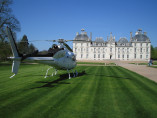 Image of the VIP excursion Loire valley castles: Cheverny and Beauregard showing loire-valley-castles-cheverny-outside-helicopter, flying with a Private Helicopter thanks to AB Corporate Aviation
