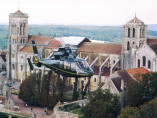 Image of the VIP excursion Vip helicopter trip to the Alps showing vip-helicopter-trip-to-the-alps-dolphin-abbaye-de-vezelay, flying with a Private Helicopter thanks to AB Corporate Aviation